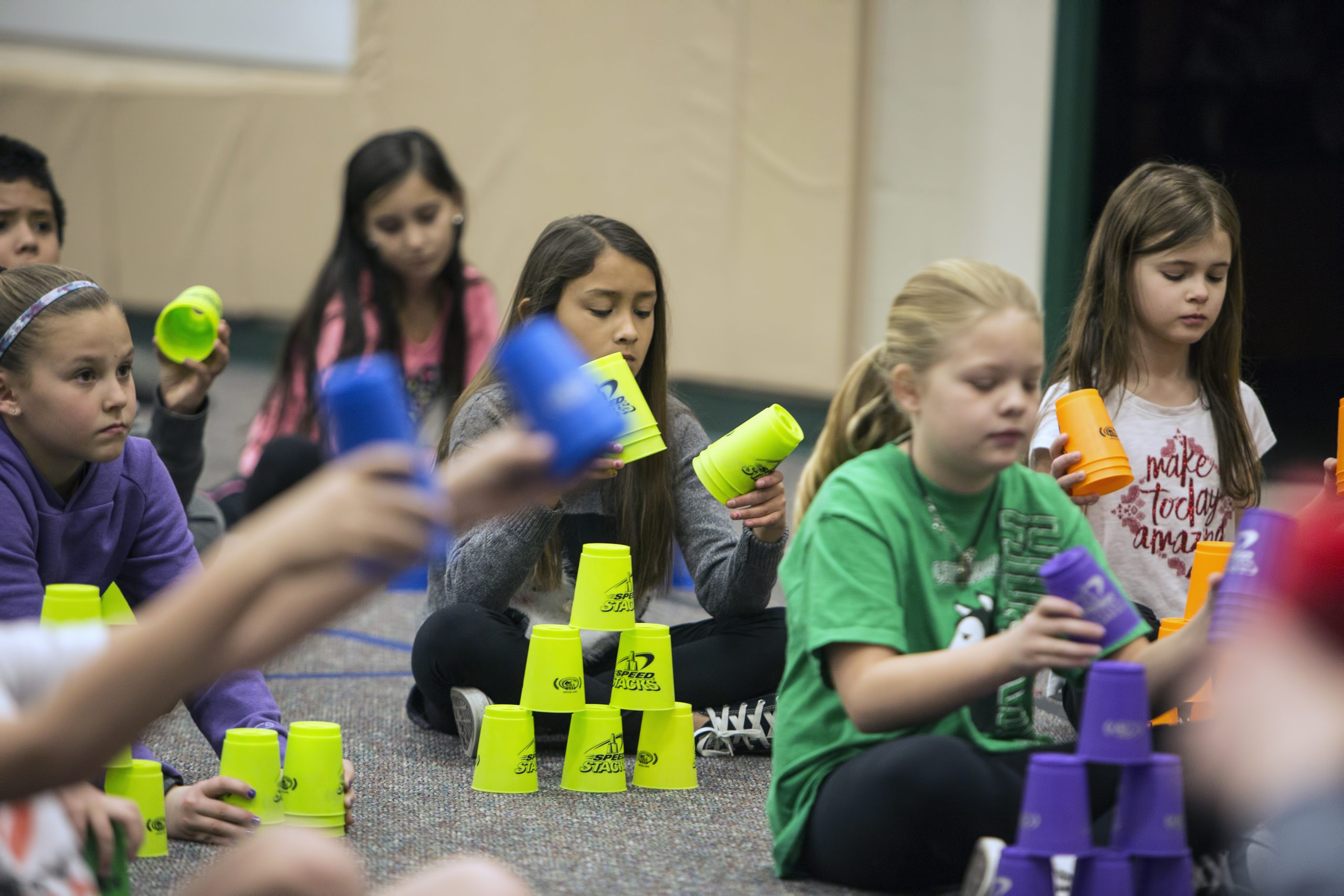 Students participating in the cup stacking challenge